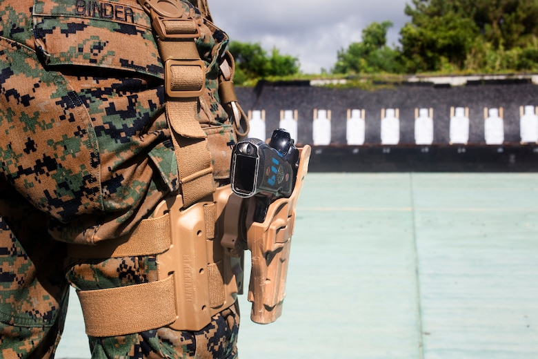 U.S. Marine Cpl. Bradley Binder conducts pistol qualification with a Beretta M9 service pistol at Camp Hansen, Okinawa, Japan, Sept. 6, 2018. Binder, a native of Milwaukee, Wisconsin, is a squad leader with 3rd Law Enforcement Battalion, III Marine Expeditionary Force Information Group. Pistol qualification is required annually to sustain the skills of pistol marksmanship.