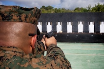 A U.S. Marine with 3rd Law Enforcement Battalion, III Marine Expeditionary Force Intelligence Group fires a Beretta M9 service pistol during pistol qualification at Camp Hansen, Okinawa, Japan, Sept. 6, 2018. Pistol qualification is required annually to sustain the skills of pistol marksmanship.