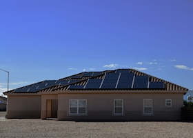 A house with solar panels sits on Luke Air Force Base, Ariz., Oct. 15, 2016.