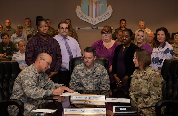 Team Travis leadership sign proclamation designating October as Domestic Violence Awareness Month