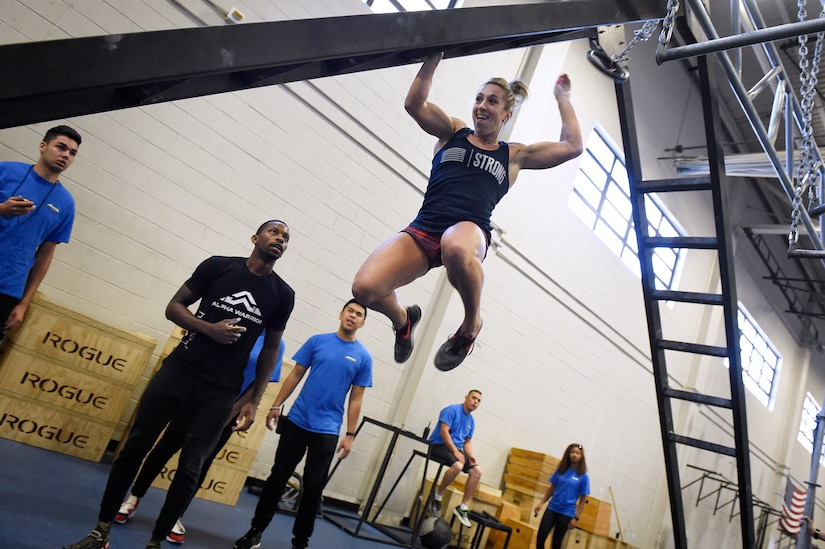 Capt. Abigail Wilkins, an Air Force ROTC instructor at Valdosta State University, Ga., leaps across an incline ladder during the Alpha Warrior regional championship Oct. 13, 2018, at Joint Base Charleston, S.C.