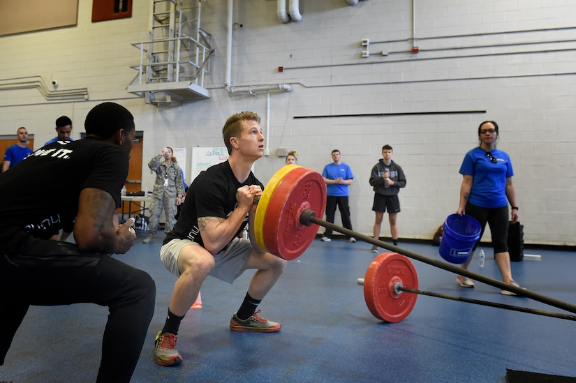 Senior Airman Jacob Wuerth, a crew chief assigned to the 437th Maintenance Squadron, performs weighted squats during the Alpha Warrior regional championship Oct. 13, 2018, at Joint Base Charleston, S.C.