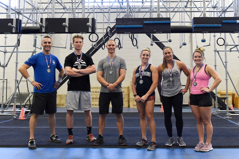The top three male and female competitors display their medals after completing the Alpha Warrior regional competition Oct. 13, 2018, at Joint Base Charleston, S.C.
