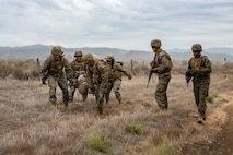 U.S. Marines with Service Company, 9th Communications Battalion, I Marine Expeditionary Force Information Group, conduct a casualty evacuation drill at Marine Corps Base Camp Pendleton, Oct. 2, 2018. The drill was part of a field exercise the battalion executed providing the Marines realistic combat training. (U.S. Marine Corps photo by Cpl. Cutler Brice.)