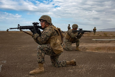 U.S. Marines with Service Company, 9th Communications Battalion, I Marine Expeditionary Force Information Group, provide security while awaiting the arrival of an aircraft during a casualty evacuation drill at Marine Corps Base Camp Pendleton, Oct. 2, 2018. The drill was part of a field exercise the battalion executed providing the Marines realistic combat training. (U.S. Marine Corps photo by Cpl. Cutler Brice.)