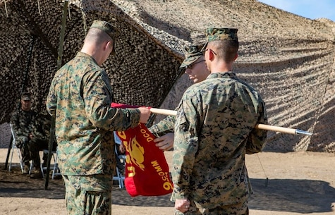 U.S. Marines assigned to Defensive Cyberspace Operations-Internal Defensive Measures Company, 9th Communications Battalion, I Marine Expeditionary Force Information Group, unveil the guidon during the activation ceremony for the DCO Company at Marine Corps Base Camp Pendleton, California, Oct. 1, 2018. The 9th Comm DCO-IDM Company is the first of three such companies the Marine Corps will activate in accordance with Force Modernization 2025. DCO-IDM Company provides added security to the Marine Corps Enterprise Network by executing offensive cyberspace operations to defend the Marine Air-Ground Task Force information networks across all domains. (U.S. Marine Corps photo by Cpl. Cutler Brice)