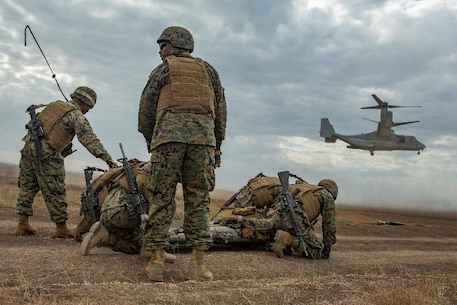 U.S. Marines with Service Company, 9th Communications Battalion, I Marine Expeditionary Force Information Group, prepare to load the simulated casualty as an MV- 22B Osprey lands for a casualty evacuation drill at Marine Corps Base Camp Pendleton, Oct. 2, 2018. The drill was part of a field exercise the battalion executed providing the Marines realistic combat training. (U.S. Marine Corps photo by Cpl. Cutler Brice.)