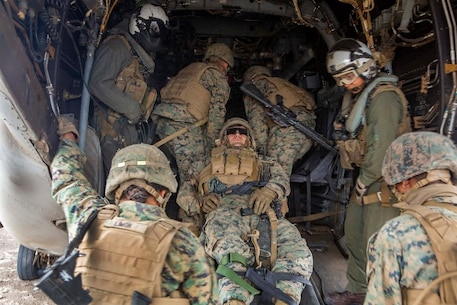 U.S. Marines with Service Company, 9th Communications Battalion, I Marine Expeditionary Force Information Group, load a simulated casualty on an MV-22B Osprey during a casualty evacuation drill at Marine Corps Base Camp Pendleton, Oct. 2, 2018. The drill was part of a field exercise the battalion executed providing the Marines realistic combat training. (U.S. Marine Corps photo by Cpl. Cutler Brice.)