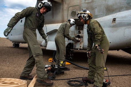U.S. Marines assigned to Marine Medium Tiltrotor Squadron (VMM) 364, 3rd Marine Aircraft Wing, prepare an MV-22B Osprey to perform an air-ground refueling operation at Marine Corps Base Camp Pendleton, California, Oct. 2, 2018. Air-ground refueling provides an alternative method to obtain fuel in a deployed environment when ground transportation is not available. (U.S. Marine Corps photo by Cpl. Cutler Brice)