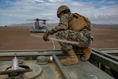 U.S. Marine PFC. Anel Sarmiento, a motor vehicle operator assigned to Service Company, 9th Communications Battalion, I Marine Expeditionary Force Information Group, checks the fuel tank level during the fuel transfer from a MV-22B Osprey to 7-ton truck carrying a fuel tank during an air-ground refueling operation at Marine Corps Base Camp Pendleton, California, Oct. 2, 2018. Air-ground refueling provides an alternative method to obtain fuel in a deployed environment when ground transportation is not available. (U.S. Marine Corps photo by Cpl. Cutler Brice)