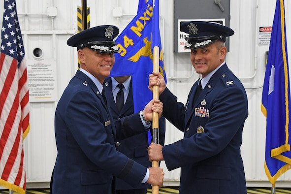 Col. Brad Douglass, right, receives the 94th Maintenance Group guide on from Brig. Gen. Richard Kemble, 94th Airlift Wing commander, during an assumption-of-command ceremony held at Dobbins Air Reserve Base, Georgia on Oct. 13, 2018.