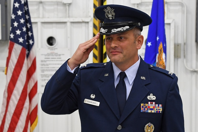 """Col. Brad Douglass renders his first salute as commander of the 94th Maintenance Group during a promotion and assumption-of-command ceremony held at Dobbins Air Reserve Base, Georgia on Oct. 13, 2018. """"I'm grateful to be leading such a high performing group of maintainers,"""" said Douglass. """"My goal is to continue leading this unit towards success and ultimately finding those little pockets of areas that we can improve to take us to the next level."""""""