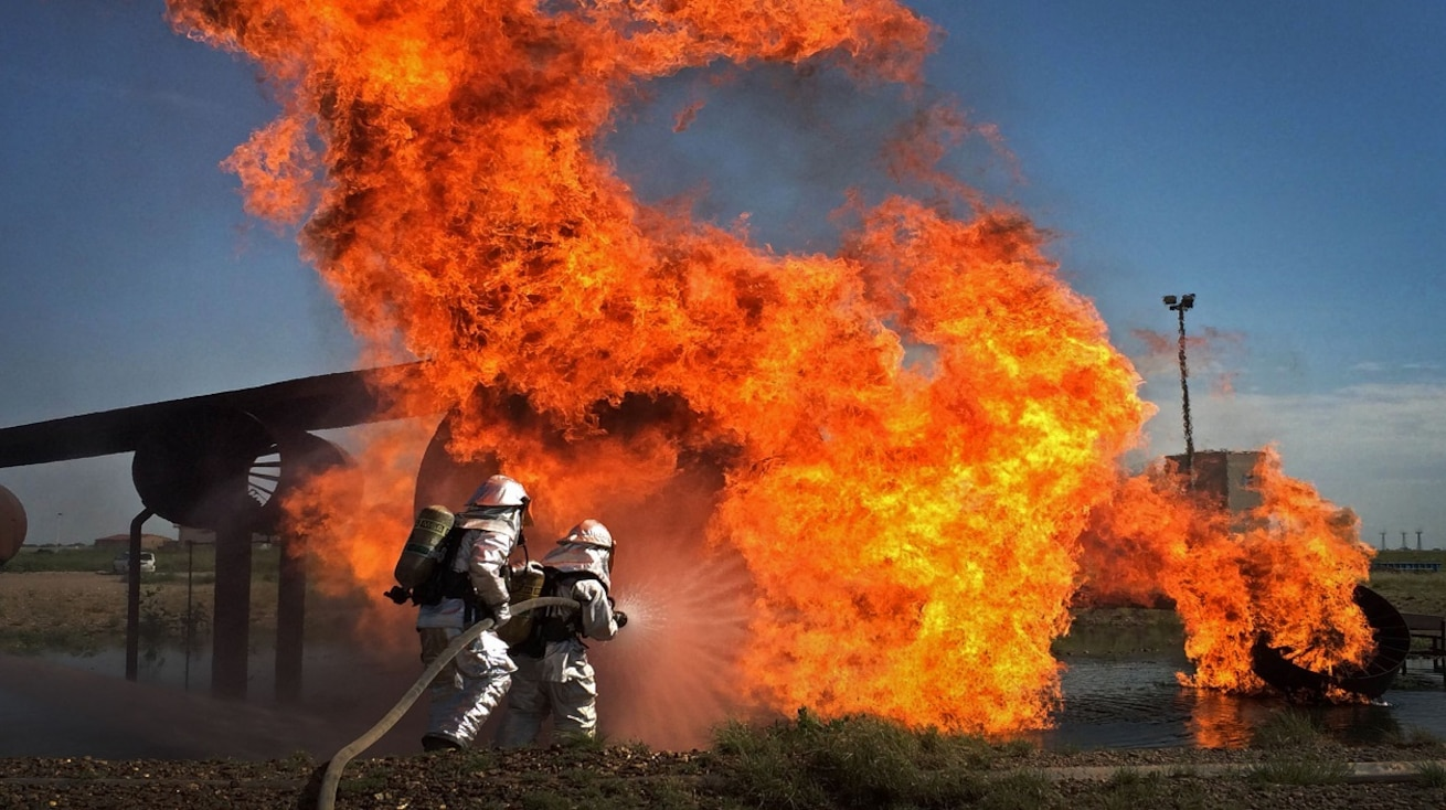 A controlled test-stite burn is put out by fire fighters