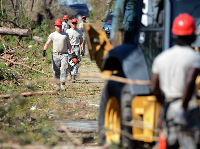 Florida Guardsmen from the 202nd REDHORSE break down fallen trees completely isolating a section of Nadine Road on Oct. 14, 2018 in Panama City, Florida. #HurricaneMichael brought 130 knot winds that uprooted and upended fully grown trees onto roadways all over the area. (U.S. Air National Guard photo by Master Sgt. William Buchanan)