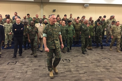 Marine Corps Gen. Joe Dunford, the chairman of the Joint Chiefs of Staff, leads his fellow chiefs of defense to a meeting on countering violent extremist organizations at Joint Base Andrews, Md.