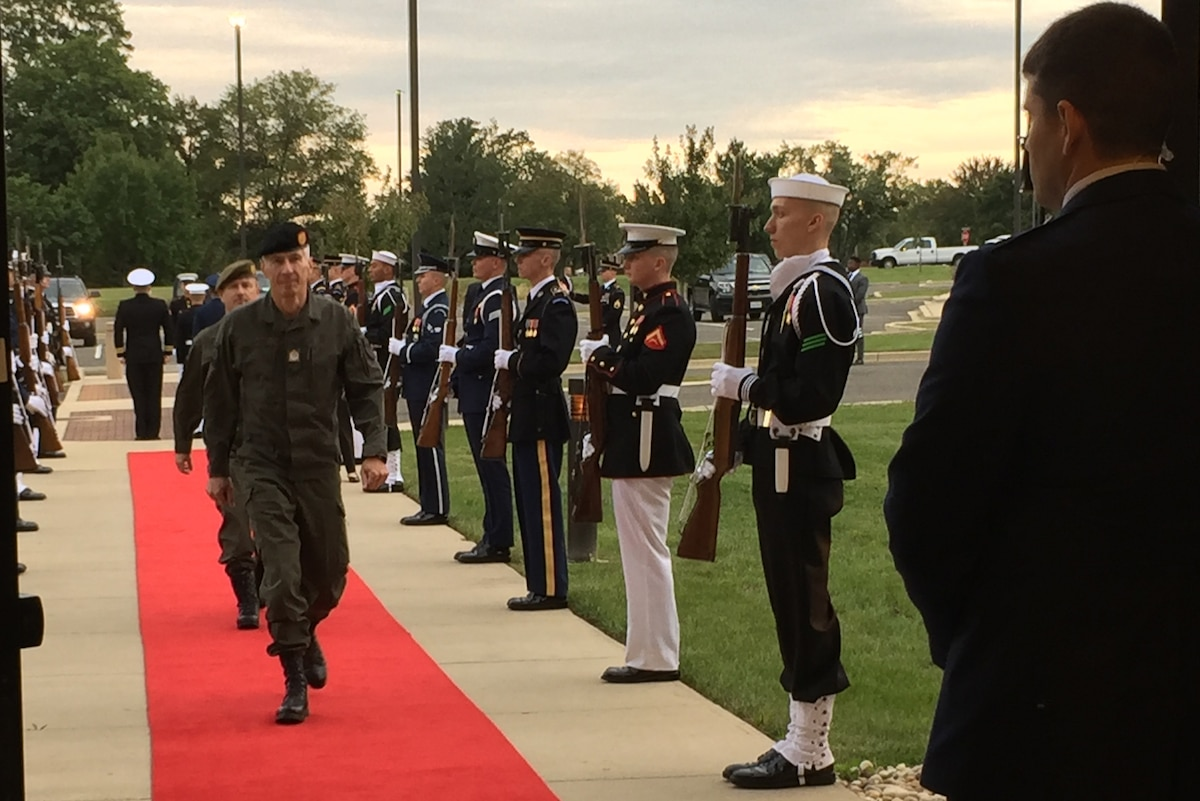 A chief of defense arrives at the Counter Violent Extremist Organization conference at Joint Base Andrews, Md.