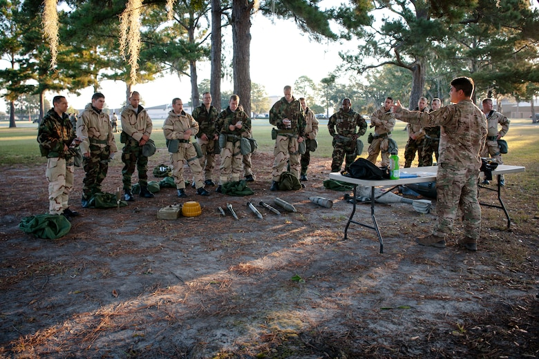 Capt. Akira Nervik, 23d Civil Engineer Squadron (CES) explosive ordnance disposal (EOD) flight commander, teaches Airmen from the 23d CES during the Ability to Survive and Operate (ATSO) Rodeo, Sept. 20, 2018, at Moody Air Force Base, Ga. Approximately 2,000 Airmen executed self-aid and buddy care, security and chemical attack avoidance missions under duress in a simulated chemical warfare environment. Testing and enhancing their operational readiness, this prepared the 23d Wing for the upcoming Phase II exercise during Nov. 5-8, 2018, which will be conducted for the first time in seven years. (U.S. Air Force photo by Airman Taryn Butler)