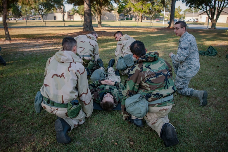 Senior Airman Derek Ketner, far right, 23d Medical Support Squadron medical lab technician, teaches self-aid and buddy care to Airmen from the 23d Civil Engineer Squadron during the Ability to Survive and Operate (ATSO) Rodeo, Sept. 20, 2018, at Moody Air Force Base, Ga. Approximately 2,000 Airmen executed self-aid and buddy care, security and chemical attack avoidance missions under duress in a simulated chemical warfare environment. Testing and enhancing their operational readiness, this prepared the 23d Wing for the upcoming Phase II exercise during Nov. 5-8, 2018, which will be conducted for the first time in seven years. (U.S. Air Force photo by Airman Taryn Butler)