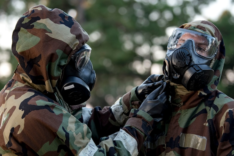 Airmen from the 23d Civil Engineer Squadron perform buddy checks during the Ability to Survive and Operate (ATSO) Rodeo, Sept. 20, 2018, at Moody Air Force Base, Ga. Approximately 2,000 Airmen executed self-aid and buddy care, security and chemical attack avoidance missions under duress in a simulated chemical warfare environment. Testing and enhancing their operational readiness, this prepared the 23d Wing for the upcoming Phase II exercise during Nov. 5-8, 2018, which will be conducted for the first time in seven years. (U.S. Air Force photo by Airman Taryn Butler)