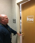 man walks to door notices FPCON Bravo sign