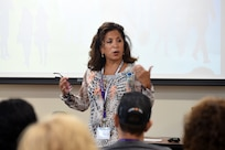 Carmella Navarro, suicide prevention program manager for the Army Reserve's Chicago-based 85th Support Command, gives opening remarks during the command's Applied Suicide Intervention Skills Training workshop, Sep. 27-28, 2018.