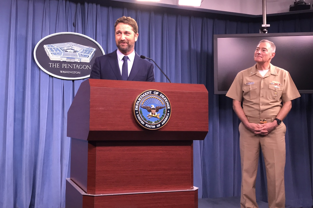 Actor Gerard Butler fields questions from reporters at the Pentagon.