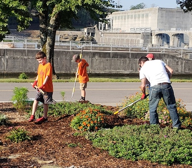 Boy Scouts with Pack 503 mulch a flower bed at Cheatham Lake Oct. 10, 2018 in Ashland City, Tenn. They joined U.S. Army Corps of Engineers Nashville District Park Rangers for the National Public Lands Day event near Cheatham Dam. (USACE photo by Dina Henninger)