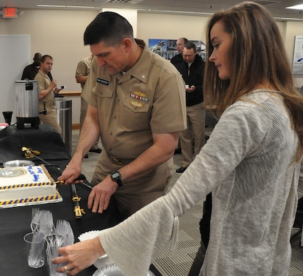 IMAGE: DAHLGREN, Va. (Oct. 12, 2018) - Cmdr. Steven Perchalski cuts the cake for those celebrating the Navy's 243rd birthday at the Naval Surface Warfare Center Dahlgren Division (NSWCDD). NSWCDD will celebrate 100 years of cutting-edge technological innovation in support of the warfighter at a centennial grand finale event Oct. 19 that includes an exhibition tent, a U.S. Navy Band performance, and historic tours featuring six station stops on base.