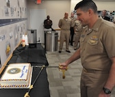 IMAGE: DAHLGREN, Va. (Oct. 12, 2018) - Cmdr. Steven Perchalski cuts the cake in celebration of the Navy's 243rd birthday at Naval Surface Warfare Center Dahlgren Division (NSWCDD). The event featured Perchalski as the command's oldest 