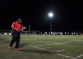 Friday Night Lights: Travis Airman leads in the community through football