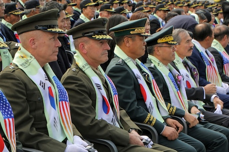 Maj. Gen. Patrick J. Hermesmann, U.S. Marine Corps Forces Korea commander (left), Maj. Gen. James W. Lukeman, U.S. Forces Korea J-5 Strategy (center-left), senior leaders from the Republic of Korea, and the honorable Harry Harris, U.S. ambassador to the R.O.K. (right), observe the commemoration for the 68th anniversary of the Battle of Chosin Reservoir in Seoul, Oct 10.  MARFORK works with the Republic of Korea Ministry of Patriots and Veterans Affairs via the U.S. Forces Korea Good Neighbor Program to honor the shared heritage of the U.S. and R.O.K.
