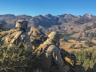Marines with 1st Battalion, 7th Marine Regiment, provide security from an observation post at Drop Zone Blackbird, during Mountain Training Exercise 6-19, at Marine Corps Mountain Warfare Training Center, Bridgeport, Calif., Oct. 14, 2018. MWTC is the only installation across the Department of Defense that conducts unit-level mountain warfare training in addition to teaching mountaineering and related skills at its professional mountain warfare schools.