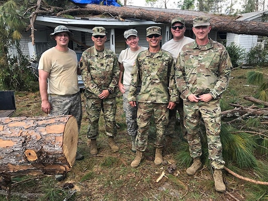 Brig. Gen. Randall Simmons, commander of the Georgia Army National Guard and Command Sgt. Major Jeff Logan, senior enlisted advisor of the 201st Regional Support Group, stand with 1st Lt. Christopher Long of the Augusta-based 877th Engineer Company and Tech Sgt. Eric Glass, Tech Sgt. Lauren Swanson and Tech Sgt. Anthony McDonnell of the Warner Robins-based 116th Air Control Wing following their emergency actions in Seminole County.