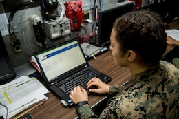 Lance Cpl. Sierra Walker, supply specialist with 13th Marine Expeditionary Unit, tests the Global Combat Support System-Marine Corps Release 12 upgrade while deployed before its official launch. The Marine Corps upgraded the system in August to strengthen the Corps' cybersecurity posture and offer a more customizable tool to ensure Marines can easily and clearly report readiness to their commander.