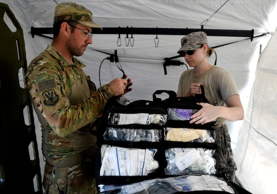 Medical technicians from the 96th Medical Group, Moody Air Force Base, Georgia, prepare to set up an operational medical facility at Tyndall Air Force Base, Florida, Oct. 15, 2018. Air Combat Command has mobilized multiple relief assets in an effort to restore operations after the hurricane caused catastrophic damage to the base. (U.S. Air Force photo by SSgt Matthew Lotz)