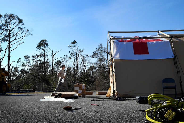 Staff Sgt. Bailey Holt, 96th Medical Group medical technician, unloads medical supplies at Tyndall Air Force Base, Florida, Oct. 15, 2018. Members from Moody Air Force Base travelled down to support standing up an operational medical facility after Hurricane Michael devastated the base. (U.S. Air Force photo by SSgt Matthew Lotz)