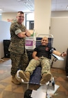 Col. John Atkinson, commanding officer of Headquarters and Service Battalion, thanks Gunnery Sgt. Carlos Perez for donating at the Armed Services Blood Program blood drive held on Sept. 11, 2018.