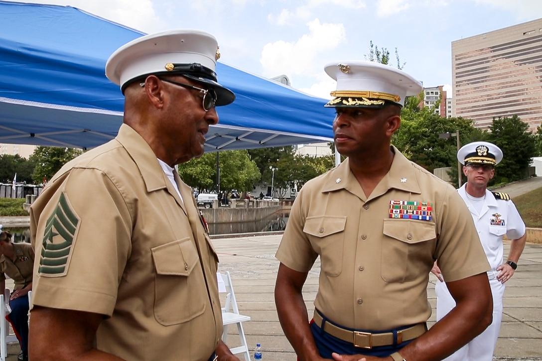 Current Marine talks with veteran Marine.
