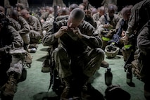 """Recruits with Delta Company, 1st Recruit Training Battalion, eat a """"Meal-Ready-To-Eat"""" during the Crucible on Marine Corps Recruit Depot Parris Island, S.C., Sept. 27, 2018. The Crucible is a 54-hour culminating event that requires recruits to work as a team and overcome challenges in order to earn the title United States Marine. (U.S. Marine Corps photo by Lance Cpl. Shane T. Manson)"""