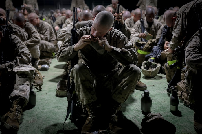 "Recruits with Delta Company, 1st Recruit Training Battalion, eat a ""Meal-Ready-To-Eat"" during the Crucible on Marine Corps Recruit Depot Parris Island, S.C., Sept. 27, 2018. The Crucible is a 54-hour culminating event that requires recruits to work as a team and overcome challenges in order to earn the title United States Marine. (U.S. Marine Corps photo by Lance Cpl. Shane T. Manson)"