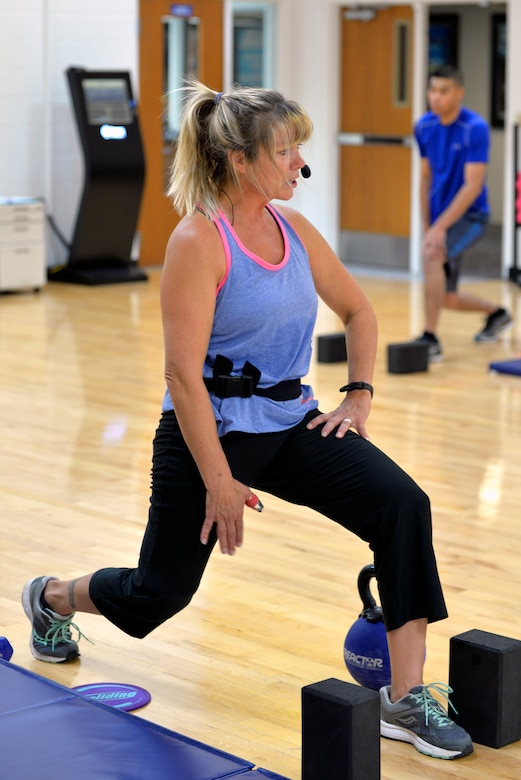 Geri Seal, the 28th Medical Operations Squadron health promotion program manager, leads a strength and core workout in the Bellamy Fitness Center at Ellsworth Air Force Base, S.D., Oct. 4, 2018. Seal meets with an average of 25 to 30 Airmen a month at the Health and Wellness Center and discusses methods for living a healthier, more active lifestyle.