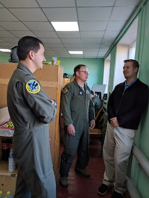 Staff Sgt. Yaroslav Bolotov (right), 56th Communications Squadron, Luke Air Force Base, Ariz., is deployed to Starokostiantyniv Air Base, Ukraine, for the Clear Sky 2018 exercise as an interpreter. Bolotov and a fellow Airmen assisted several Ukrainians after a car wreck on Saturday. At Clear Sky, Bolotov has been providing interpretation for the ground control tower, coordinating aircraft taxiing and making sure the taxiways are clear. (Courtesy Photo)