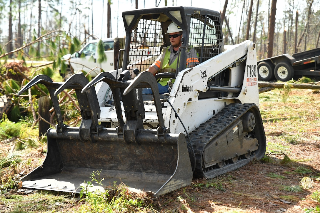 A U.S. Army Corps of Engineers Mobile District contractor cleans up fallen trees and other debris from Hurricane Michael at the Lake Seminole Project Oct. 16, 2018. USACE Mobile District Commander Col. Sebastien P. Joly visited the Lake Seminole Project Office and Jim Woodruff Lock and Dam to meet employees, hand out supplies and observe the recovery effort.