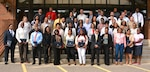 Graduates from Defense Logistics Agency's Pathways to Career Excellence Program gather for a class photo on graduation day Oct. 10, 2018, in front of the Frank B. Lotts Conference Center on Defense Supply Center Richmond, Virginia.