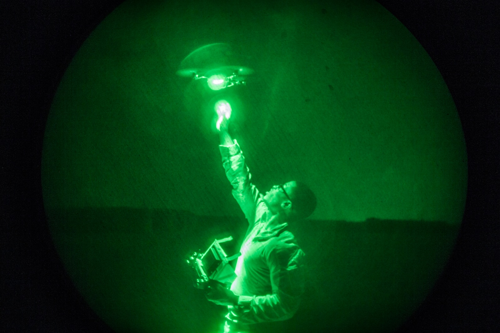 UNDISCLOSED LOCATION, SOUTHWEST ASIA – U.S. Marine Corps Cpl. Justin Johnson, an intelligence analyst with 3rd Battalion 7th Marine Regiment attached to Special Purpose Marine Air-Ground Task Force, Crisis Response-Central Command (SPMAGTF-CR-CC), recovers an Instant Eye quadcopter system out of the night sky July 27, 2018. SPMAGTF-CR-CC Marines regularly support Task Force Spartan, whose mission is to advise and assist Iraqi forces in the Ramadi area. (U.S. Marine Corps photo by Cpl. Gabino Perez)