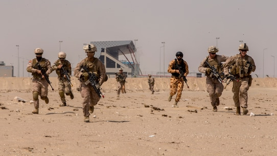 UNDISCLOSED LOCATION, SOUTHWEST ASIA – U.S. Marines with 3rd Battalion 7th Marine Regiment, 1st Marine Division attached to Special Purpose Marine Air-Ground Task Force, Crisis Response-Central Command and Kuwait Armed Forces service members rush to their objective during exercise Invincible Sentry August 8, 2018. SPMAGTF-CR-CC works with partner nations on maintaining regional security through joint operations and exercises. (U.S. Marine Corps photo by Cpl. Gabino Perez)