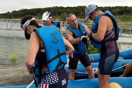 Members of Joint Base San Antonio prepare for the rafting portion of the Rambler 120 Oct. 13, 2018, at JBSA Recreation Area at Canyon Lake, Texas.