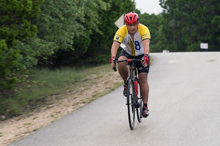 A member of Joint Base San Antonio raced on his bike during the Rambler 120 Oct. 13, 2018, at JBSA Recreation Area at Canyon Lake, Texas.