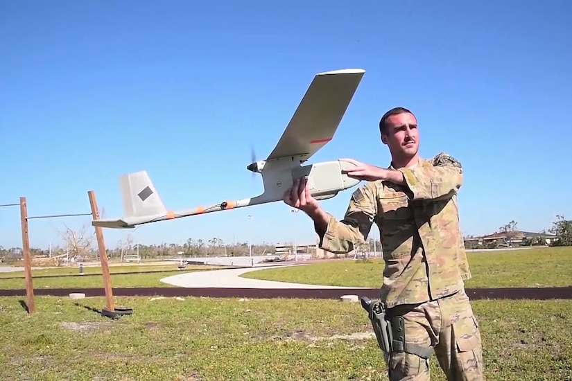 Screenshot of man holding a Raven unmanned aircraft.