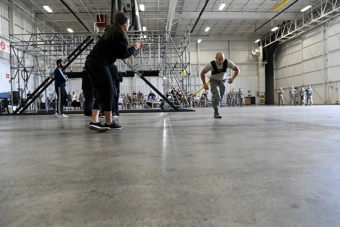 An Airman with the 911th Airlift Wing participates in a time challenge using the Alpha Warrior Battle Rig at the Pittsburgh International Airport Air Reserve Station, Pennsylvania, October 14, 2018. The battle rig is designed to meet all four of the Comprehensive Airman Fitness model's pillars: mental, physical, social and spiritual. (U.S. Air Force photo by Staff Sgt. Zachary Vucic)